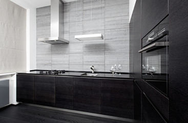 Part of modern minimalism style kitchen interior in monochrome
