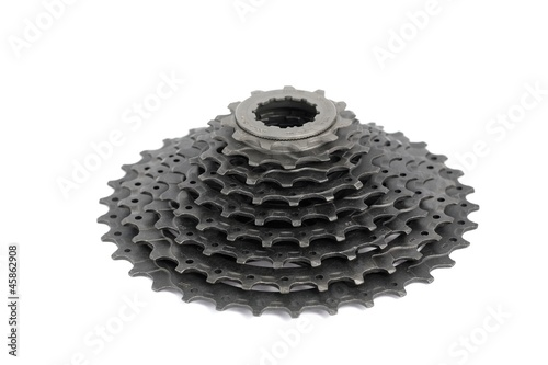 New nine speed rear bicycle sprocket on a white background