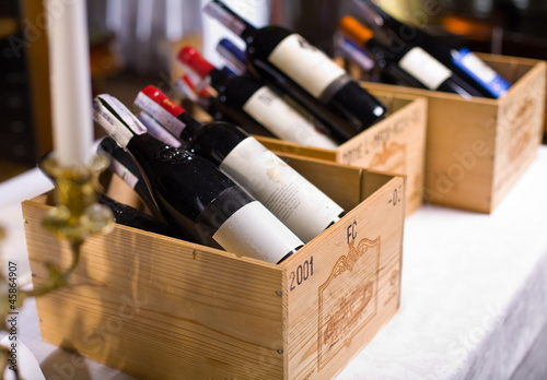Wine bottles in wooden boxes. - 45864907