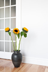 Sunflowers decorating a room