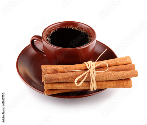 Cup of coffee with cinnamon sticks isolated