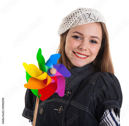 Young cute brunette girl with wind turbine toy