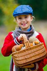 Season for mushrooms -  girl with basket of picked mushrooms