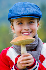 Season for mushrooms -  girl with picked fresh edible mushroom