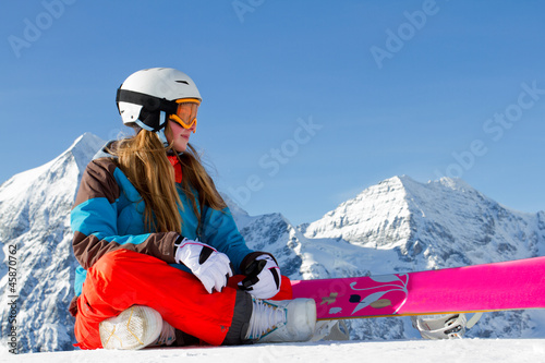 Winter sport - portrait of young snowboarder girl