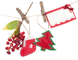 Christmas decorations and card hanging on a rope