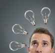 Businessman thinking concept with a light bulb of