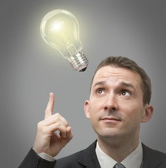 Businessman thinking concept with a light bulb on