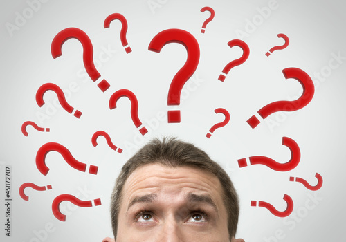 Man thinking concept with question marks close up