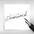 Teamwork Handschrift auf weißem Papier