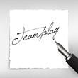 Teamplay Handschrift auf weißem Papier