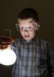 schoolboy holding glowing bulb