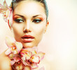 Beautiful Girl With Orchid Flowers. Beauty Woman Face