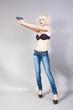 Blond girl holding a gun