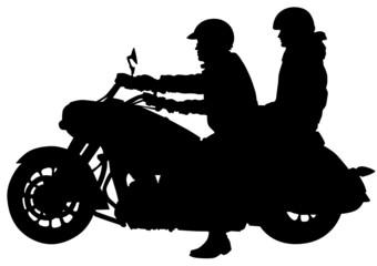 Pair on bike