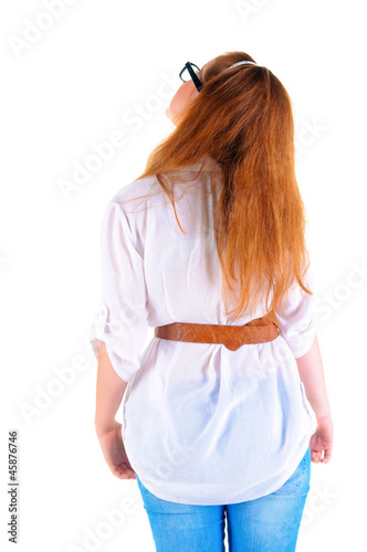 back view of standing redhaired woman