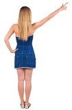 back of view beautiful young  woman in jeans dress pointing at w