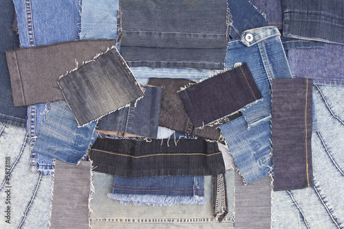Abstract background of overlapping pieces of denim.