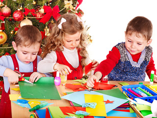 Children  making decoration for Christmas.