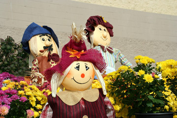 Decorative fall scarecrows at an outdoor garden center