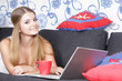 young happy smiling woman with laptop working at home