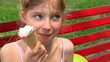 Child eating ice-cream outdoor.