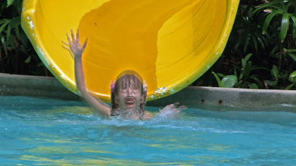 Child riding on water slide.