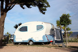 Small caravan on a camping site in Spain poster