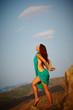 Beautiful girl standing on a precipice