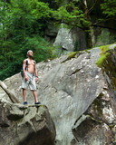Man with backpack on rock