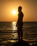 Silhouette of man in sunset