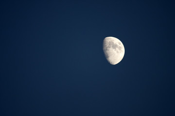 Moon shining on an evening sky