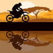 Motorbike rider motorcycle silhouette in wild mountain landscape