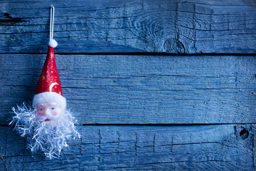 Santa Claus christmas  toy on vintage wooden boards background