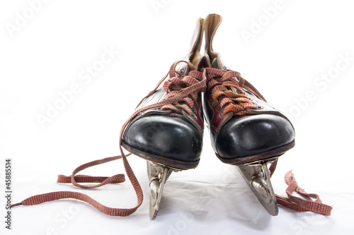 Two very old ice hockey skates on white background