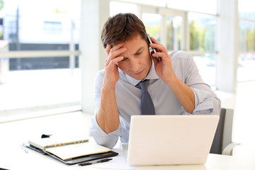 Businessman on the phone with worried look