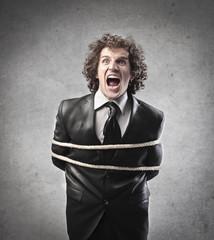 Tied Businessman Screaming
