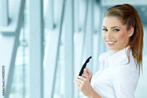 Businesswoman standing inside a modern house