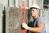 builder facade plasterer worker with level