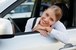 businesswoman sitting in the car and smiling
