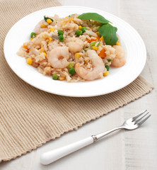 Rice and shrimps with vegetables top view
