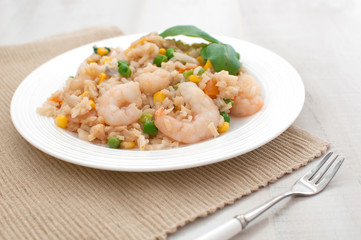 Plate of rice and shrimps with vegetables