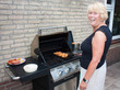Retired dutch senior woman grilling pork chops