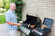 Retired dutch senior man grilling meat