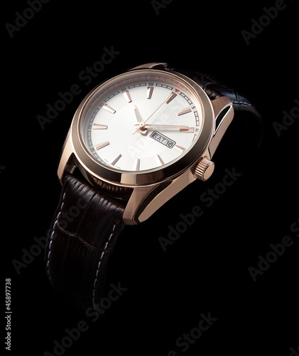 luxury watches with a leather strap on a black background