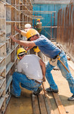 Construction builders positioning concrete formwork frames poster