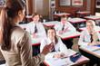 female high school teacher teaching in classroom