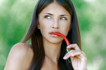 dark-haired pensive woman in his mouth paprika