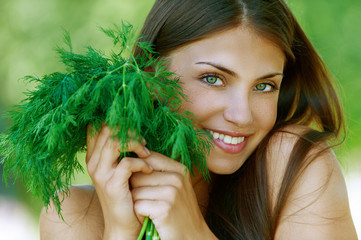 cheerful young woman holding parsley