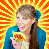 Happy woman with cherry tomatos salad